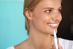 Woman With Beautiful Smile, Healthy Teeth Using Whitening Pen Stock Photo