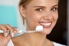Woman With Beautiful Smile, Healthy White Teeth With Toothbrush. Dental Care. Closeup Of Beautiful Smiling Woman With Perfect Smile, Healthy White Teeth And royalty free stock image