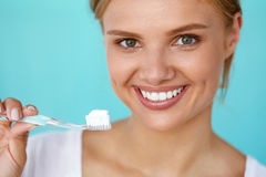 Woman With Beautiful Smile, Healthy White Teeth With Toothbrush Stock Images
