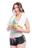 Woman with a beautiful smile holding an apple Royalty Free Stock Photography