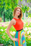 Woman with a beautiful smile near tree in the park Royalty Free Stock Photo