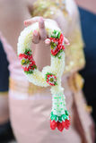 Woman in beautiful thai dress hold thai garland Stock Images