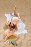 Woman with beautiful white sarong on the beach Royalty Free Stock Photos