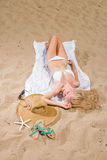 Woman with beautiful white sarong on the beach Stock Images