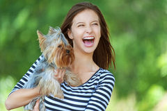 Woman beautiful young holds small Royalty Free Stock Photography