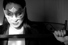 Woman. Beautiful young woman with white mask royalty free stock photos