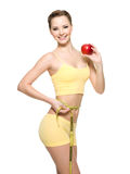 Woman with beautifulbody measuring the wistline Royalty Free Stock Image