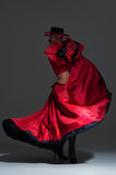 Woman in beautifull red dress dancing Stock Image