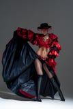 Woman in beautifull red dress dancing Stock Photo