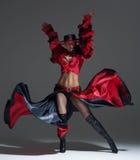 Woman in beautifull red dress dancing Stock Photography