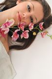 Woman beauty. Beauty halth and spa wellness isolated young woman face portrait closeup with towel and flower treatment Royalty Free Stock Photography