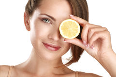 Woman beauty concept with fruits slices over eyes Stock Photography