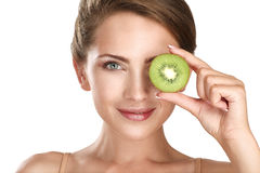 Woman beauty concept with fruits slices over eyes Stock Photos