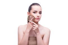 The woman in beauty concept with magnifying glass aging wrinkles Stock Image