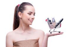 The woman in beauty concept with make up holding shopping cart. Woman in beauty concept with make up holding shopping cart royalty free stock image