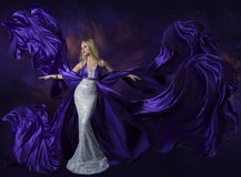 Woman Beauty Dress Flying Purple Silk Cloth, Lady Creative Fashion Gown Flowing and Waving on Wind, Beautiful Girl Elegant stock image