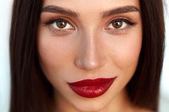 Woman With Beauty Face And Beautiful Makeup And Sexy Red Lips. Fashion Beauty Woman Portrait. Closeup Of Beautiful Fashionable Young Woman Face With Perfect Royalty Free Stock Photo