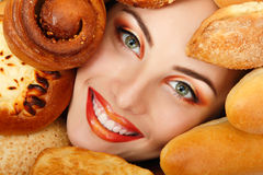Woman beauty face with bread bun patty baking food. Frame Royalty Free Stock Image