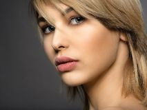 Woman with beauty face and clean skin. blonde woman. Attractive blond model with blue eyes. Fashion model with a smokey makeup. Closeup portrait of a pretty stock photo