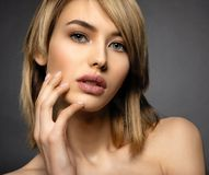 Woman with beauty face and clean skin. blonde woman. Attractive blond model with blue eyes. Fashion model with a smokey makeup. Closeup portrait of a pretty royalty free stock photography