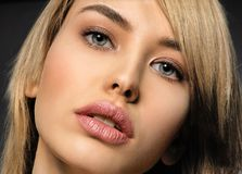 Woman with beauty face and clean skin. blonde woman. Attractive blond model with blue eyes. Fashion model with a smokey makeup. Closeup portrait of a pretty royalty free stock photos
