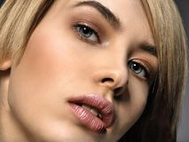 Woman with beauty face and clean skin. blonde woman. Attractive blond model with blue eyes. Fashion model with a smokey makeup. Closeup portrait of a pretty stock photography