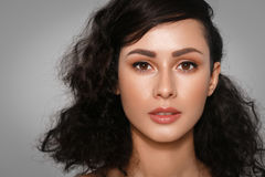 Woman beauty face closeup with many curly black hair portrait is. Olated  with healthy skin. Studio shot Stock Image
