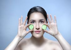 Woman beauty face with cucumber stock photo