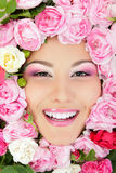 Woman beauty face with flower roses frame Stock Photo