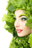 Woman beauty face with green fresh lettuce leaves Stock Photos