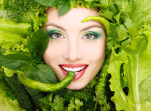 Woman beauty face with greens vegetables and pepper frame Royalty Free Stock Images