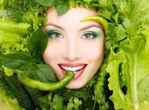 Woman beauty face with greens vegetables and pepper frame Stock Images