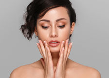 Woman beauty face hand touching with many curly black hair portr Royalty Free Stock Images