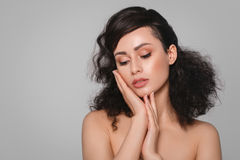 Woman beauty face hand touching with many curly black hair portr Stock Photo