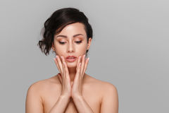 Woman beauty face hand touching with many curly black hair portr Stock Photography