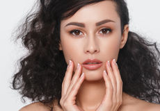 Woman beauty face hand touching with many curly black hair portr Royalty Free Stock Photo