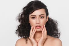 Woman beauty face hand touching with many curly black hair portr Royalty Free Stock Photography