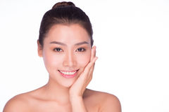 Woman with beauty face and perfect skin. Portrait of the woman with beauty face and perfect skin isolated on white background, asian model Stock Images