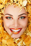 Woman beauty face with unhealth eating fast food potato chips Royalty Free Stock Image