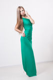 Woman in beauty fashion green dress Royalty Free Stock Images
