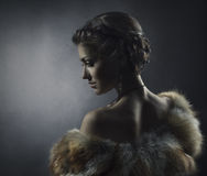 Woman beauty, fox fur coat, beautiful retro girl. Woman beauty in luxury fox fur coat, beautiful girl retro vintage style Stock Images