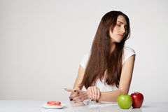 Woman beauty girl with fruits and donut apple on gray white background Royalty Free Stock Images