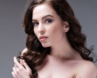 Woman with beauty long brown hair - posing at studio Stock Photography