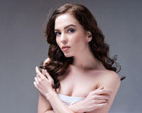 Woman with beauty long brown hair - posing at studio Stock Image