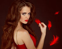 Woman with beauty long curly brown hair. And red lips. Fashion woman Portrait stock image