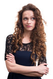 Woman with beauty long curly hair thinking Royalty Free Stock Photos
