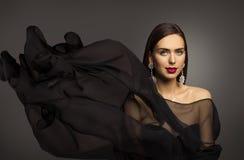 Woman Beauty Makeup, Fashion Model Portrait, Waving Black Fabric. Cloth Flying on Wind royalty free stock photo