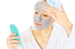 Woman with beauty mask. Young woman taking care of her skin Royalty Free Stock Photos