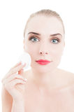 Woman beauty model using face cleaner disc. To remove make-up and cosmetics royalty free stock image