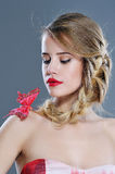 Woman beauty portrait with butterfly on her shoulder Royalty Free Stock Image